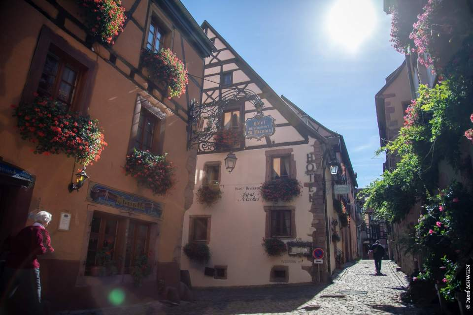 The cobbled street in front of Le Manala Restaurant in Riquewihr